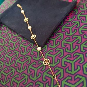 Tory Burch logo gold tone with pearl bracelet